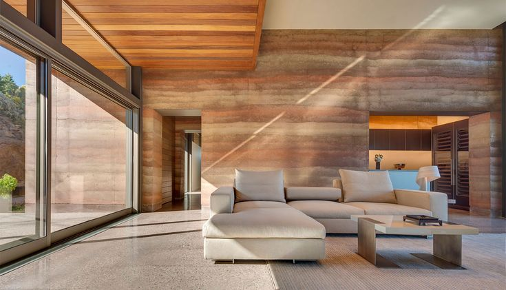 The rammed earth walls in the Torcasso residence incorporate four different shades of indigenous soil, creating a deep luscious palette in irregular sedimentary layers. - © Robert Reck