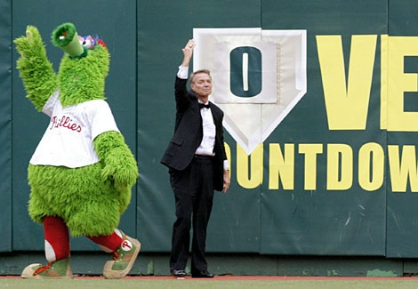 """Hall of Fame broadcaster Harry Kalas and the Phanatic wave to the crowd after removing the last of the """"Vet Countdown"""" signs in the Braves-Phillies game Sunday, Sept. 28. The game was the final one played at 33-year-old Veterans Stadium. (Rusty Kennedy/AP)"""