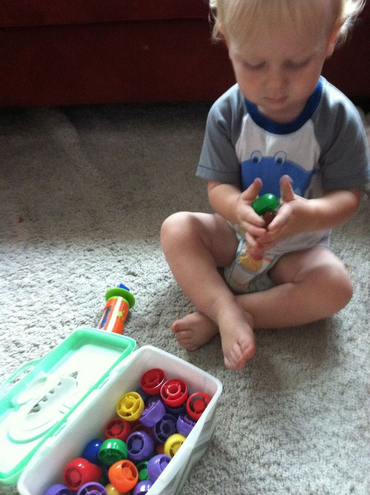 Whenever G finishes off a squeezy food pouch, I clean the lid and toss it in a wipes container.  He loves to get the box out and just play, sometimes pushing the lids through the box's opening and sometimes stacking.  These are super versatile learning tools that we can later use to sort, count, or pattern!