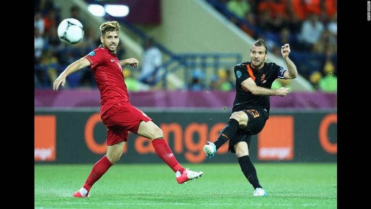 Rafael van der Vaart of the Netherlands scores the opening goal past Miguel Veloso of Portugal. CNN.com