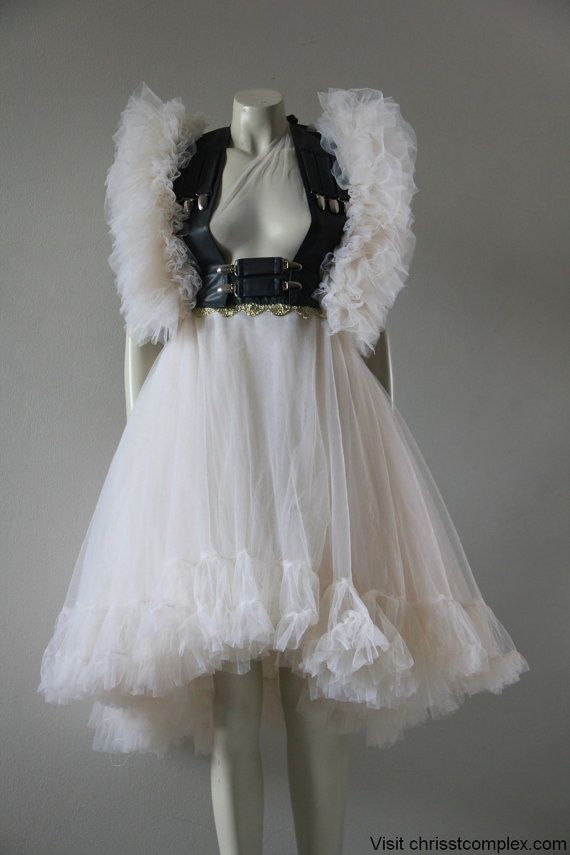 Leather and tule, girly and badass. Love it. I'd really have no place to wear it. But damn, it's fabulous.