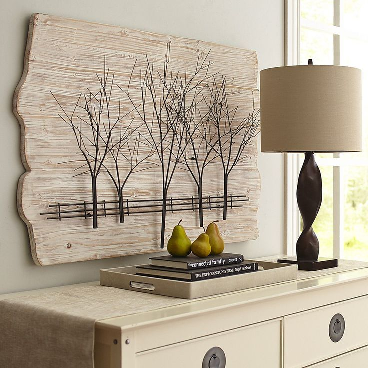 Bring some of the outdoors into your apartment with bright, airy sculpted artwork from Pier 1.