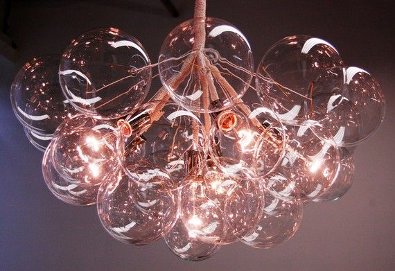 Clean, modern, industrial, traditional or chic. This light suits any room setting.      The Bubble Chandeliers are delicate and airy compositions of luminous glass globe clusters. Each light is carefully composed and hand built by the designers in their Brooklyn studio.