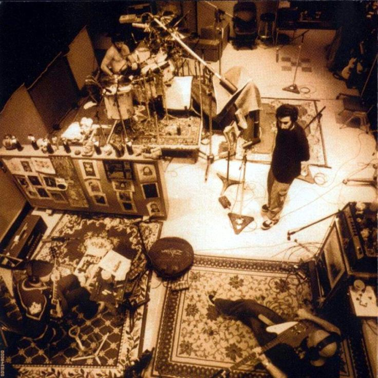 System of a Down. .Toxicity Album (love to have a look in the kitchen part of every work and was wondering of this picture when I watched it) why CARPETS? ???