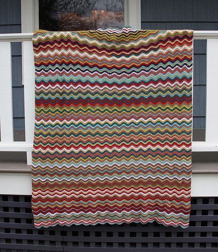 This webpage generates random stripe patterns for sweaters, scarves, blankets, etc. It'll give you an idea of what the finished object will look like, but it still leaves some unpredictability to the stripe pattern. Great for knitting or crocheting projects.