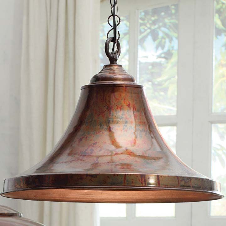 While it has a shape closer to a standard lamp shade there is nothing ordinary about this flared pendant with a copper finish could be paired with or used