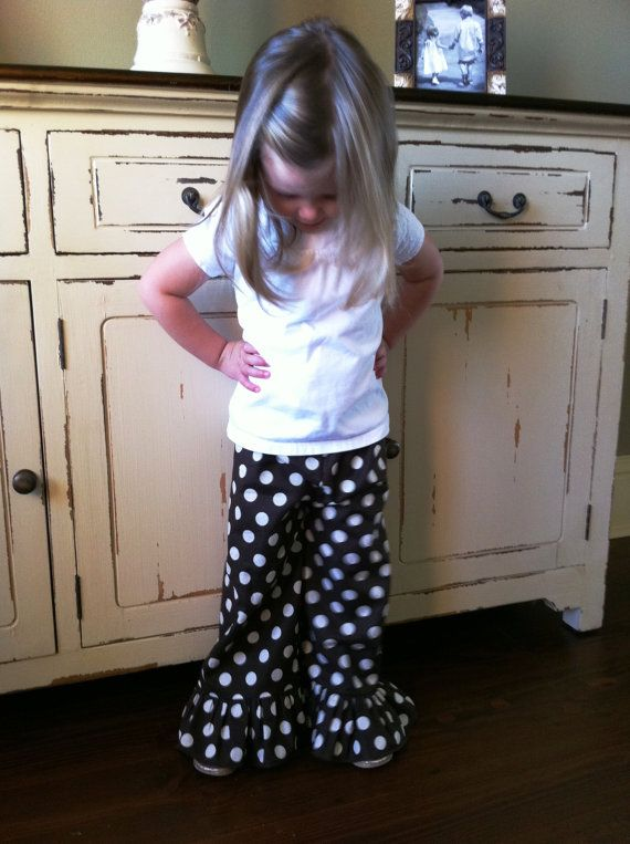 My mom got a sewing machine to teach her children and grandchildren to sew. I am excited to be one of her students and learn how to make adorable clothes for Ella like these pants.