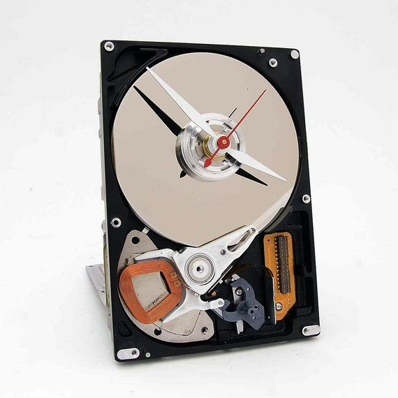 Apparently this clock is made of recycled computer hard drive parts. So basically I want one.