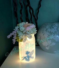 DIY FAIRY JAR.... Use Mod Podge & glitter the outside of a jar. Cut a fairy from black vinyl & stick it to the inside, glue flowers to the jar lid, and use battery operated string lights from Michaels on the inside. Such a cute idea to make with the kids!