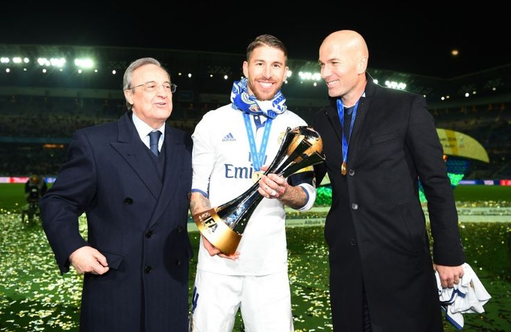 Zinedine Zidane, Manager of Real Madrid (R) Sergio Ramos of Real Madrid (C) and Florentino Pérez (L) pose with the trophy during the FIFA Club World Cup Final