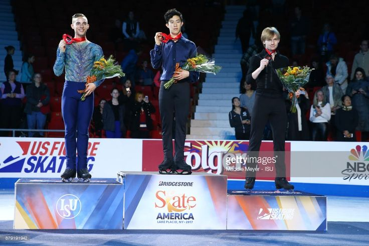 From left, silver medalist Adam Rippon of the United States, gold medalist Nathan Chen of the United States and bronze medalist Sergei Voronov of Russia pose for the Mens medal ceremony on Day 2 of the ISU Grand Prix of Figure Skating at Herb Brooks Arena on November 25, 2017 in Lake Placid, United States. SKATE AMERICA 2017