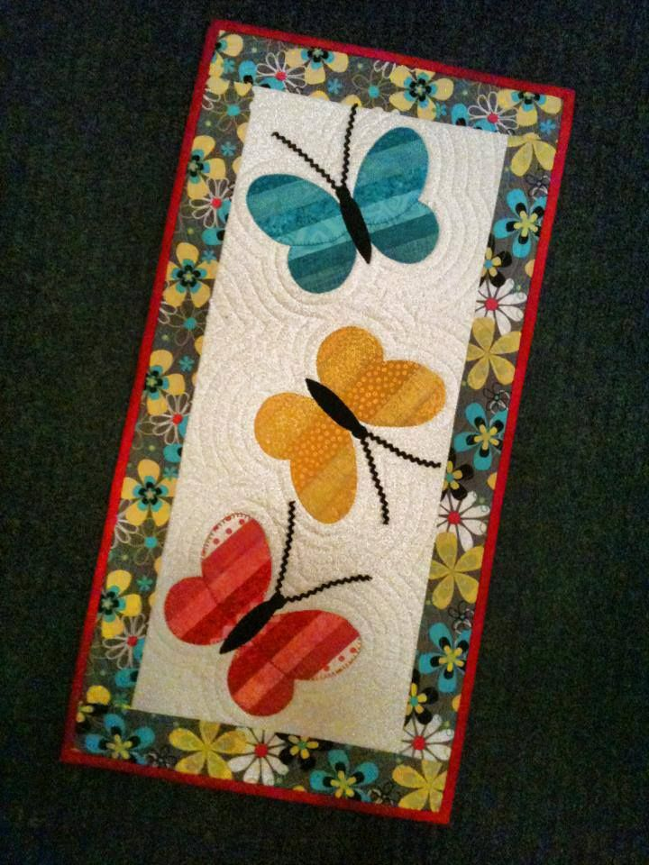 "Each quilt is appliqued and can be a wall quilt or table runner is approx. 14"" x 28"". This pattern has 3 great wall hangings."