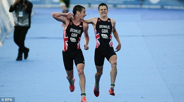 Jonny Brownlee helped over line by brother Alistair before collapsing