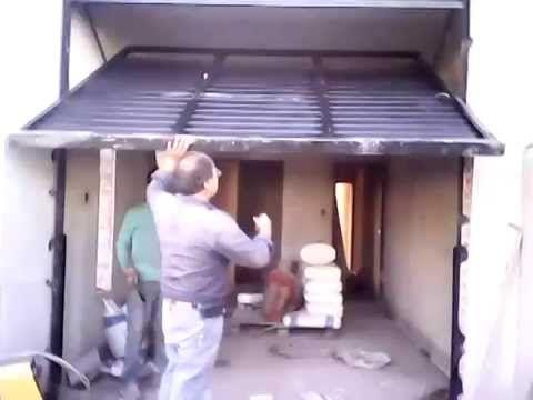 porton levadizos sarmiento de gral pico - YouTube