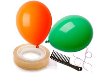 Two equal sized threads, two balloons, one comb, adhesive tape