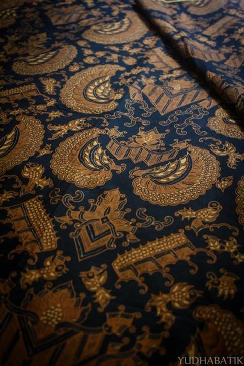 "Stamped Solo batik in ""Semen Romo"" pattern. Semen romo intepreted as a prosperous life, therefore a required pattern to drawn on semen romo, such as gurda, birds (represents air), floral, mammals (represents land) and fishes, snakes or frog (represents water), depicted the concept of 'Tribawana' - Solo, Central Java"