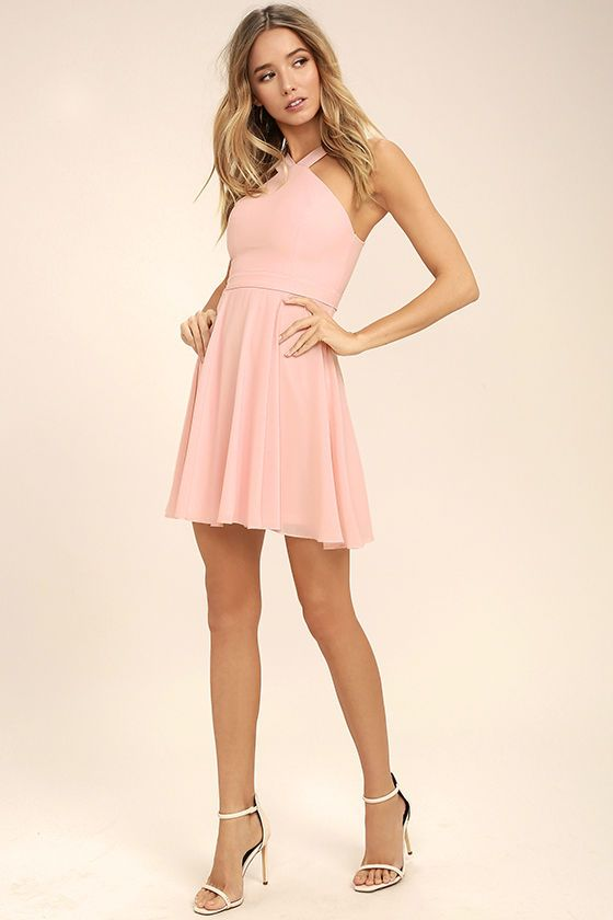Our hearts will belong to the Forevermore Light Pink Skater Dress 'til the end of time! Semi-sheer shoulder straps form a modified halter neckline atop a fitted bodice with princess seams. A flirty skater skirt, composed of lightweight Georgette, flares below a banded waist. Hidden back zipper/clasp.