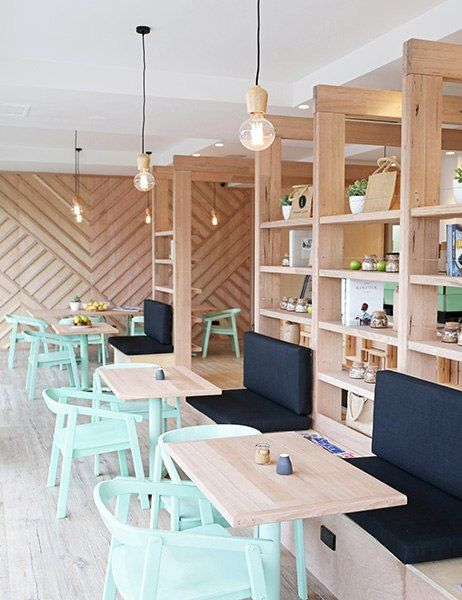 The owners of this Melbourne juicery decided to use Victorian ash on the shop's tables, shelves, and geometric feature wall. Customers are welcome to sip one of the company's 35 fruit and vegetable combinations while sitting back on mint-green chairs. pressedjuices.com.au