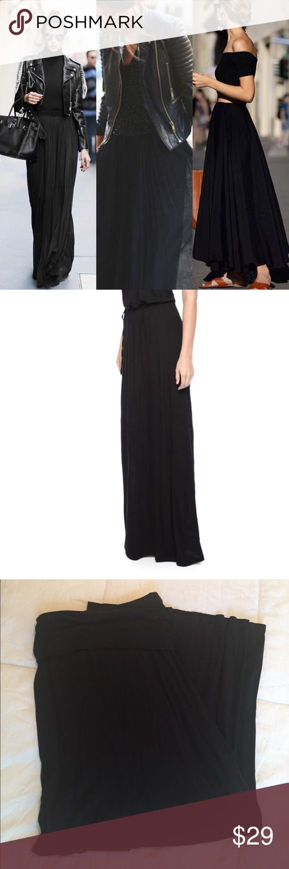 """Black jersey maxi skirt by Splendid size xs Black jersey maxi skirt by Splendid size xs. In excellent used condition cotton jersey material with the perfect amount of stretch. Comfy style to dress up or down. Waist can be folded down or worn high waisted. No side slit. This is too long for me so I'm selling. Length from waist to hem is 43"""" Splendid Skirts Maxi"""