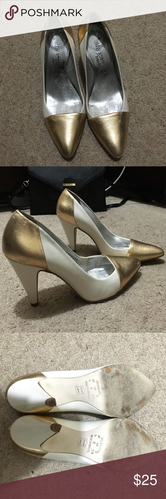 Cute white and gold pumps Cute, size 8 white pumps with gold accent on the toe and heel. Shoes were made in Brazil. Cathy Jean Shoes Heels