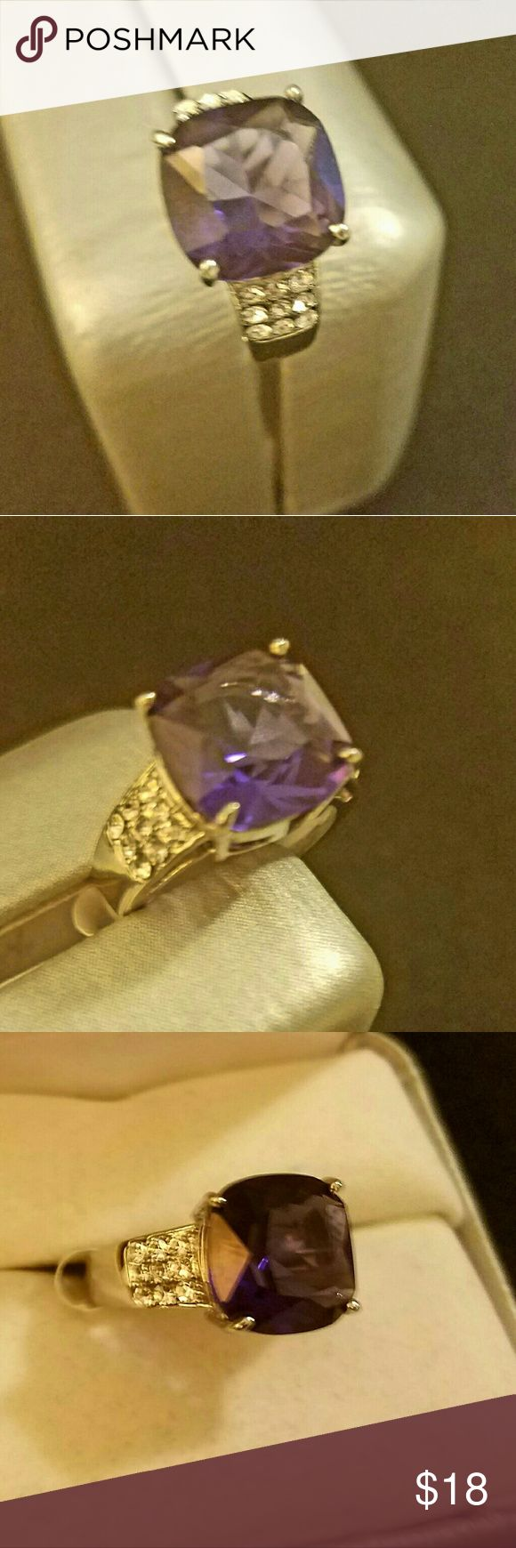 Sterling Silver Amethyst Ring PLEASE LET ME KNOW WHAT SIZE YOU NEED BEFORE YOU BUY, TY!   Size 7 sterling silver stamped ring.  Gorgeous Amethyst  ring with 3 rows of czs down the sides. This is February  birthstone.  I usually sale my rings at my kiosk for $35 plus tax.  So you are getting great quality rings for half the price.   New, never worn.  Box in picture is for display purposes only. . Let me know if you need a different size because I may have it in stock.  I tried to show the…