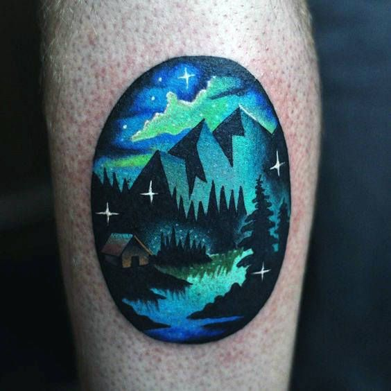 Small Simple Northern Lights Male Leg Tattoo