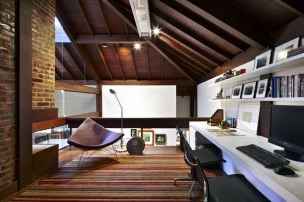 Attic office we love featuring exposed beams