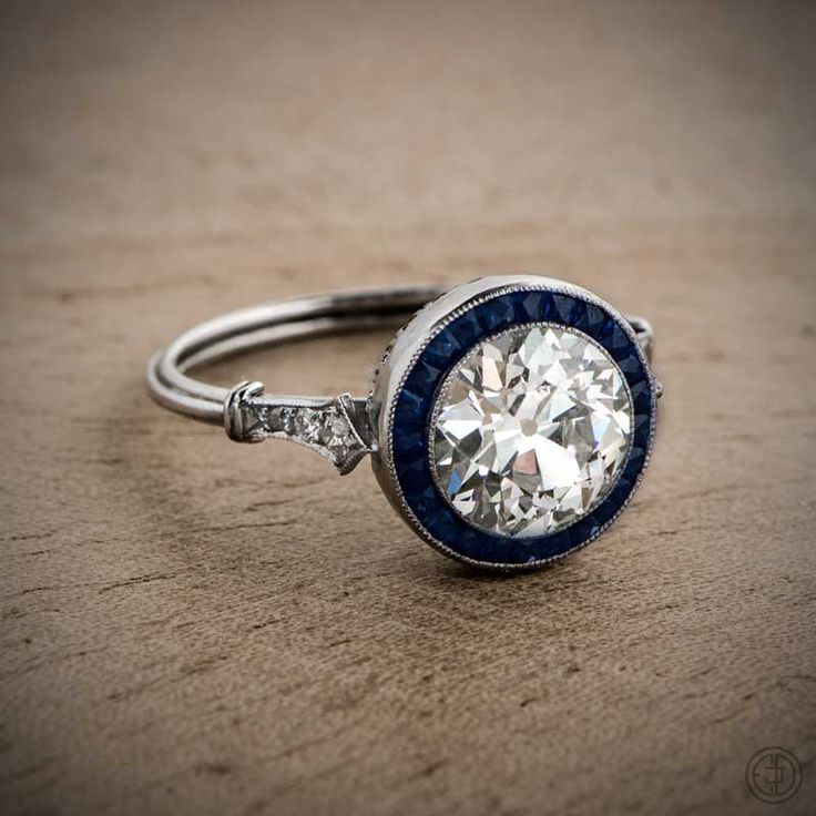 A beautiful Old European Cut Diamond Engagement Ring with a Sapphire Halo.