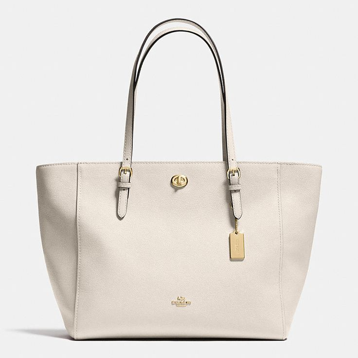 Crossgrain leather adds subtle texture to an effortless, go-anywhere tote with ample room for essentials. Buckled strap anchors, a polished metal hangtag and a hidden pocket secured with a petite turnlock give it a quintessential Coach finish.