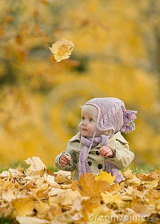 Magical pic of baby girl in autumn leaves. Love the one stray leaf falling above her. #babysfirstsapp
