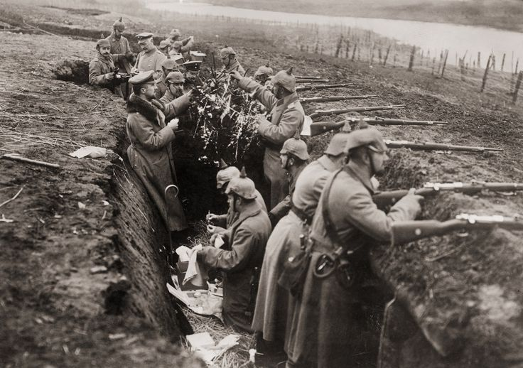 German soldiers take a moment to decorate the trenches in celebration of Christmas during World War I.