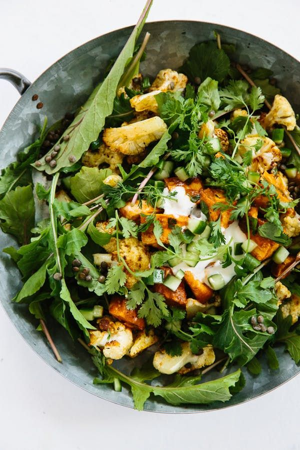 Chicken Tika Misala This bowl turns Indian takeout upside down, with a bed of roasted cauliflower spiced up with curry powder and cilantro, tossed with spicy arugula and lentils.