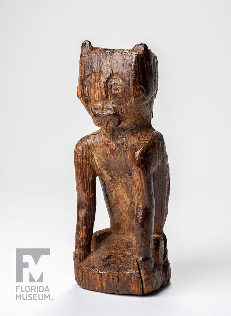 Object #74   Wooden Figurine => Read & Listen: https://www.floridamuseum.ufl.edu/100years/wooden-figurine/ ------------------------- This rare Wooden Figurine probably depicts a kneeling performer wearing a cat-like mask, one of only four such figurines known. Discovered early in the 1920s by Robert Padgett, it recently came to the Museum via his descendants. #archaeology #nativeamerican #collections #ethnography #FM100Yrs