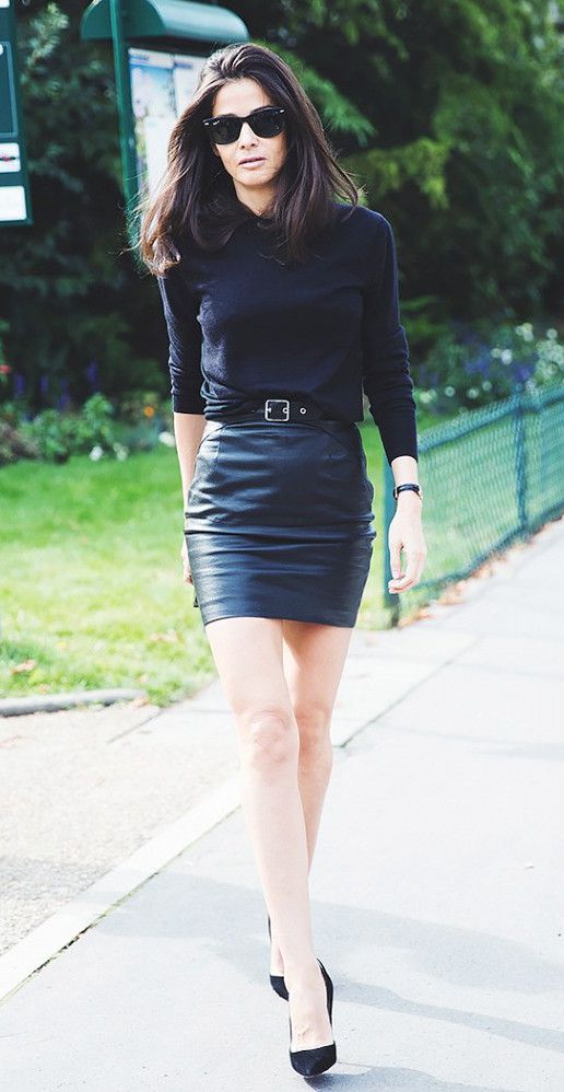 All black outfit complete with a belted leather mini skirt and pumps