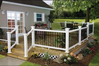 traditional wood deck with vinyl and iron railing