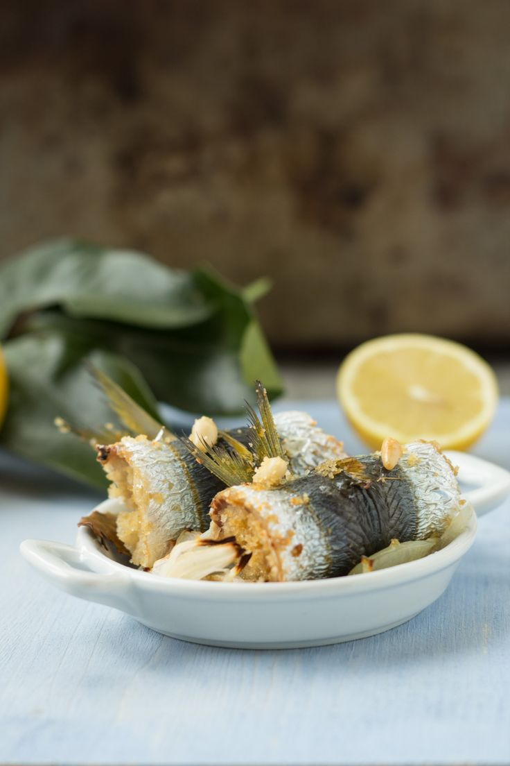 Sarde a beccafico is one of the most traditional dishes of Sicily, particularly in Palermo. They are rolls of sardines stuffed with breadcrumbs flavored with lemon juice or oranges, pinenuts and raisins #Italy #food