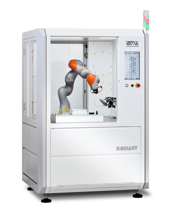 X Smart module - Ceramic White version with KUKA iiwa cobot.  Perfect example of robot/operator co-working.