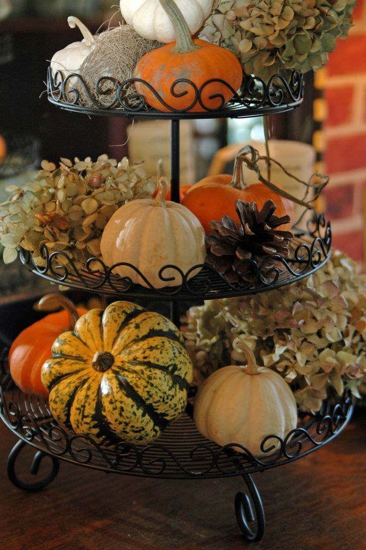 This tiered desert tray is perfect for creating a tall fall arrangement! add dried Hydrangea blossoms, a pine cone, a birds nest and some small pumpkins to each level