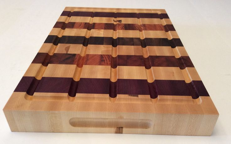 A personal favorite from my Etsy shop https://www.etsy.com/ca/listing/268466698/wooden-endgrain-butcher-block-with-juice
