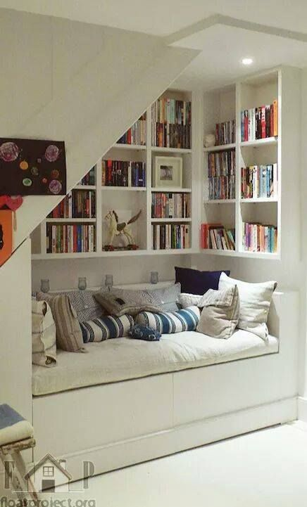 small library - possibly in a bedroom or under a stairs