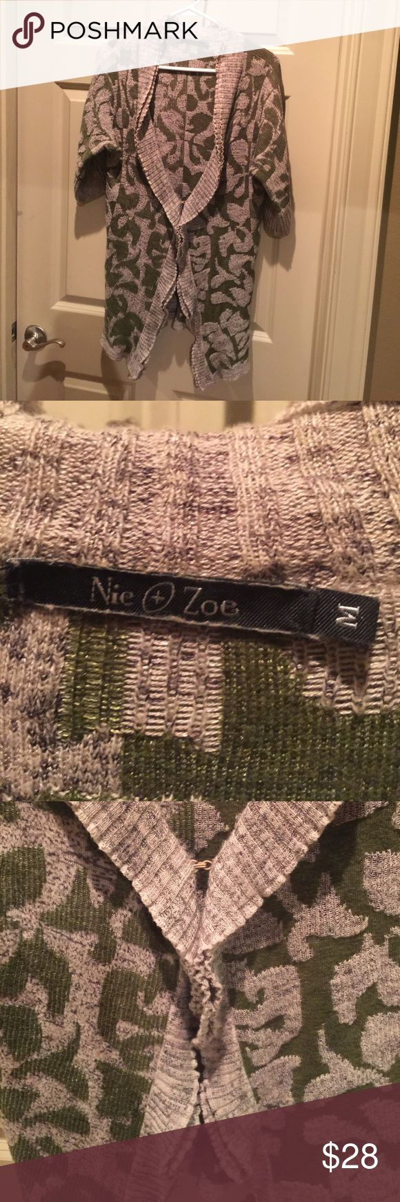 """Nic + Zoe distressed/damask inspired cardigan Nordstrom brand: Nic + Zoe army green and taupe/gray distressed/damask inspired cardigan fastens at waistline size is a true Medium fit.  Hits me mid thigh and I'm 5'6"""".  Has a slight shimmery effect but not a metallic thread. Very cool and transitional for fall/winter/spring. Pair with a gorgeous shift dress/skirt or opt to go casual in jeans and a white Tee. I am uncertain about the exact blend, my guess is a poly cotton with a TAD bit of…"""