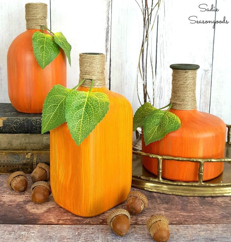 Repurpose and upcycle your glass wine and liquor bottles as decorative pumpkins and gourds for Fall decor with this amazing hand-painting tutorial!