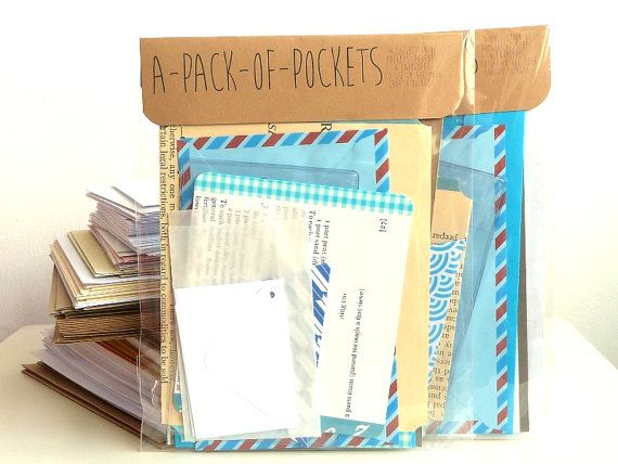 A *blue* PACK-of-POCKETS. A collection of pouches, envelopes & pockets for all your crafty doings. [From https://www.etsy.com/uk/shop/JulieKirk]