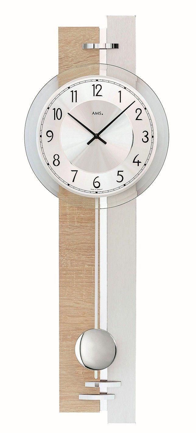 AMS Wandklok met slinger Sonoma/Aluminium 7441. Mooie wandklok uitgevoerd in een houten behuizing van Sonomahout en is met Aluminium afgewerkt. Werkt op een batterij. De klok is 67 hoog, 23 cm breed en 7 cm diep. De wijzerplaat is zilverkleurig en de klok heeft gefacetteerd Mineraalglas. De slinger heeft geen invloed op de werking van de klok en mag desgewenst weggelaten worden. https://www.timefortrends.nl/wekkers-klokken/ams-klokken.html