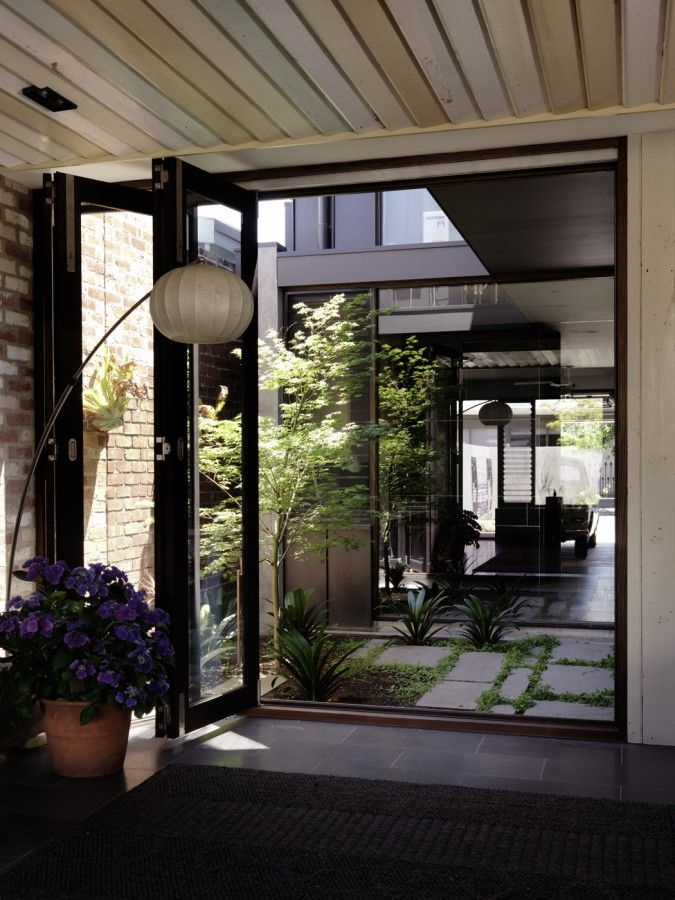 The perfect internal courtyard - flow through to other parts of the house, integrated, green and light. The Melbourne Laneway House - Wilson ID architects