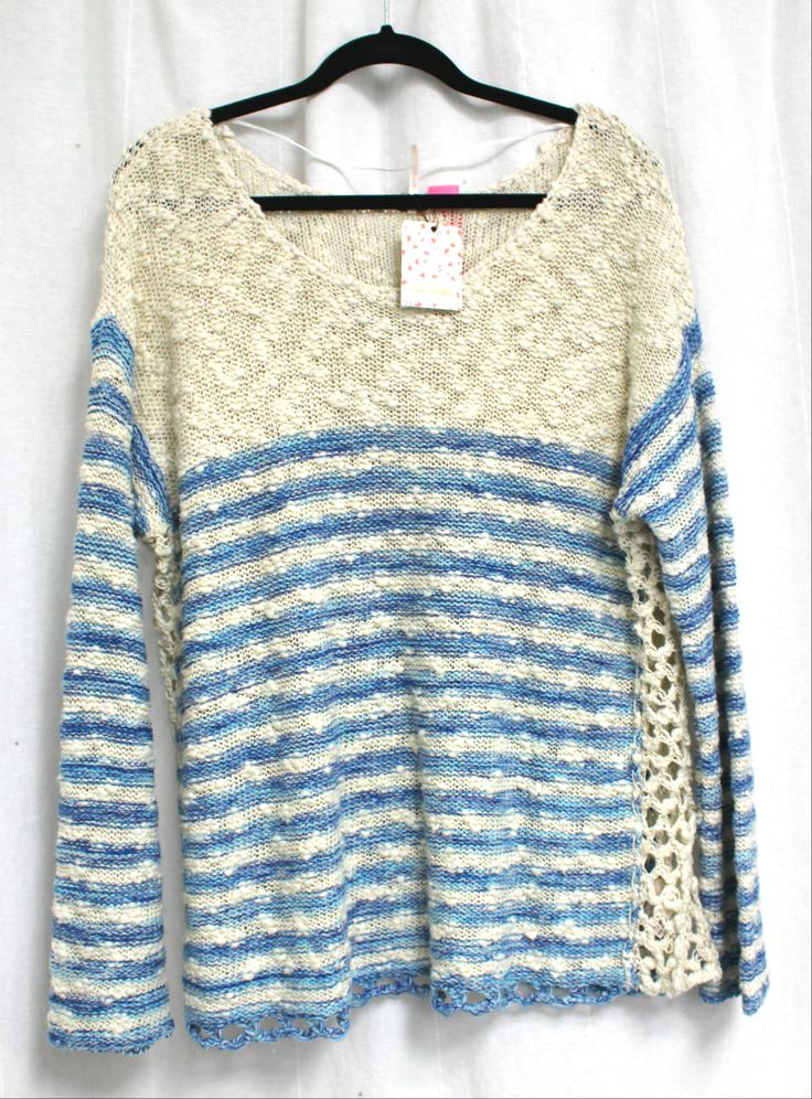 Free People sweater, brand new with tags on, at a fraction of retail.