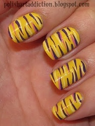 LSU nail art! GEAUX TIGERS!! Im thinking purple nails and tiger stripes on my toes this season.