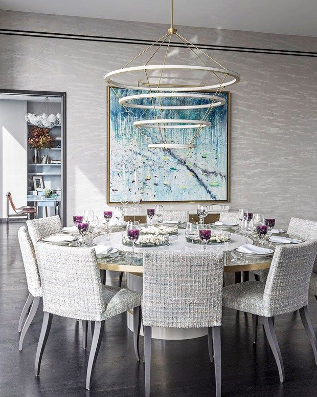 Dining Room with modern chandelier, round table, and grey grasscloth wallpaper. Interior Designer: Jamie Drake, via @sarahsarna.