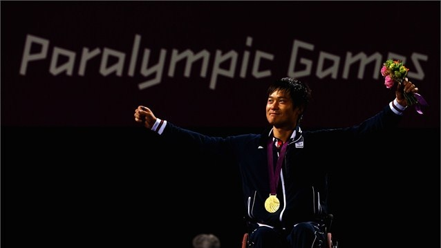 hingo Kunieda of Japan celebrates victory over Stephane Houdet of France in the men's Wheelchair Tennisgold medal match on Day 10 of the London 2012 Paralympic Games at Eton Manor.