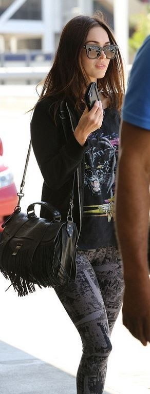 Who made  Megan Fox's black sunglasses, sneakers, and fringe leather handbag?